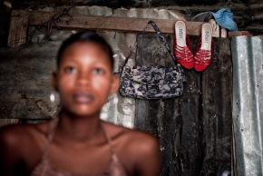 Jeneuse with the first new pair of red shoes that she's bought since the earthquake :: July 2010 :: Port au Prince :: Photo copyright: Richard Hanson :: shot for Tearfund
