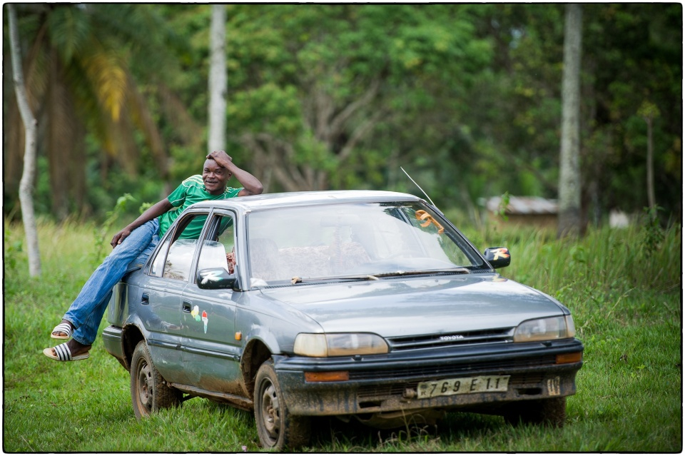 Our driver Francis with his Corolla, Kolo, Congo, October 2012 :: copyright Richard Hanson for Bible Society