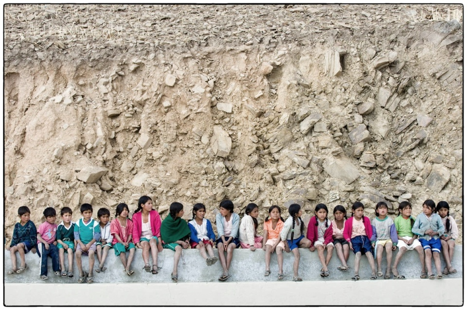 Pupils from Guitarrani primary school watching their friends playing football, Bolivia, 2005 :: photo copyright Richard Hanson for Tearfund
